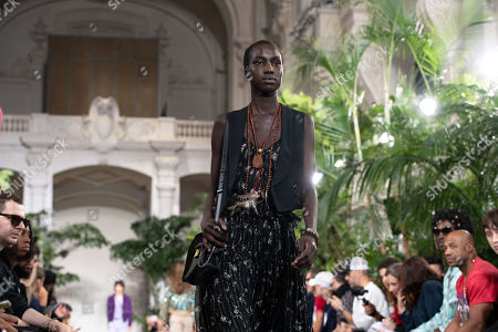 Stock Image of A model presents a creation from the Spring/Summer 2020 Men's collection by US designer Mike Amiri for his label Amiri during the Paris Fashion Week, in Paris, France, 20 June 2019. The presentation of the Spring/Summer 2020 menswear collections runs from 18 to 23 June 2019.