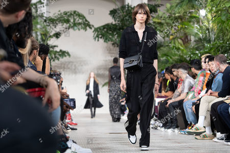 Stock Photo of Models present creations from the Spring/Summer 2020 Men's collection by US designer Mike Amiri for his label Amiri during the Paris Fashion Week, in Paris, France, 20 June 2019. The presentation of the Spring/Summer 2020 menswear collections runs from 18 to 23 June 2019.