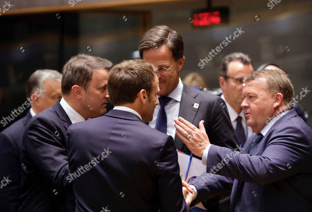 Danish Prime Minister Lars Lokke Rasmussen, right, speaks with from left, Luxembourg's Prime Minister Xavier Bettel, French President Emmanuel Macron and Dutch Prime Minister Mark Rutte during a round table meeting at an EU summit in Brussels, . European Union leaders meet for a two-day summit to begin the process of finalizing candidates for the bloc's top jobs