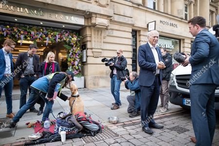 Stock Picture of Vince Cable arrives to meet Big Issue sellers in Manchester City Centre, alongside Cllr John Leach and Jane Brophy MEP