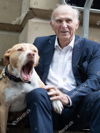 Vince Cable meets Big Issue seller Justin Green (49) and his dog Bumper (ten) in Manchester City Centre