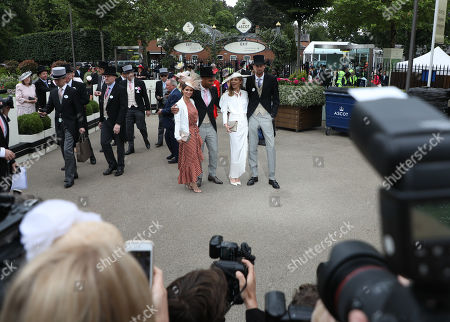 Glen Johnson and his wife Laura, with Peter Crouch and his wife Abigail Clancy stand infront of photographers on Ladies Day on Day 3 of Royal Ascot