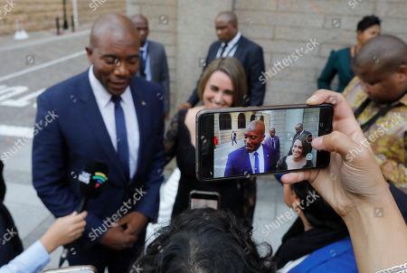 Leader of the opposition party the DA, Mmusi Maimane (L) and his wife Natalie Maimane (R) are pictured by a mobile phone during the annual State of the Nation (SONA) address and opening of the national parliament in Cape Town, South Africa, 20 June 2019.