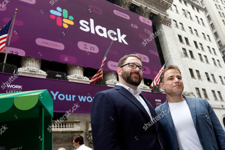 Stewart Butterfield, Cal Henderson. Slack co-founders Cal Henderson, left, and Stewart Butterfield pose for photos outside the New York Stock Exchange before their company's IPO