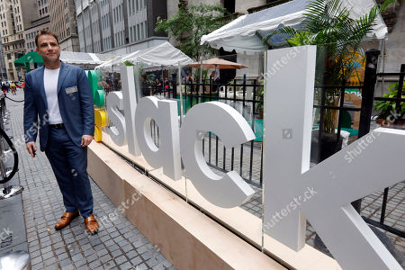 Slack CEO Stewart Butterfield poses for photos outside the New York Stock Exchange before his company's IPO