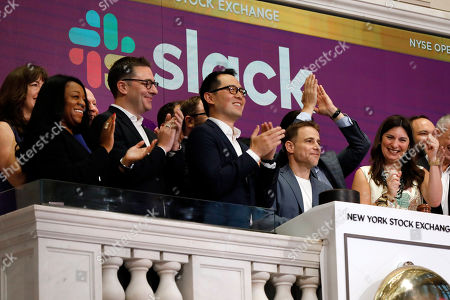 Stock Photo of Stewart Butterfield, Stacey Cunningham. Slack CEO Stewart Butterfield, second from right, is applauded as he rings the New York Stock Exchange opening bell, before his company's IPO, . NYSE President Stacey Cunningham is at right