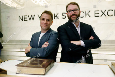 Stewart Butterfield, Cal Henderson. Slack Technolegies co-founders Stewart Butterfield, left, and Cal Henderson pose for photos on the New York Stock Exchange trading floor before their company's IPO