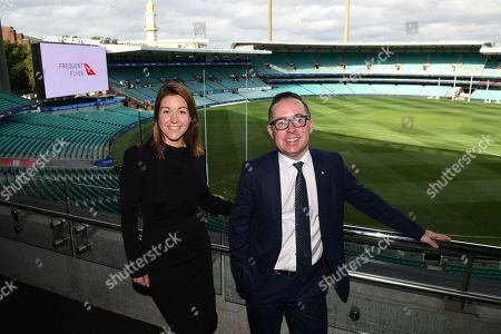 Qantas Group CEO Alan Joyce and Qantas Loyalty CEO Olivia Wirth (L) pose for a photograph at the Sydney Cricket Ground, in Sydney, New South Wales, Australia, 20 June 2019. Qantas has announced a 25 million Australian dollar (17.3 million US dollar) overhaul of its frequent flyer program, cutting fees and making it easier for passengers to cash in their points.