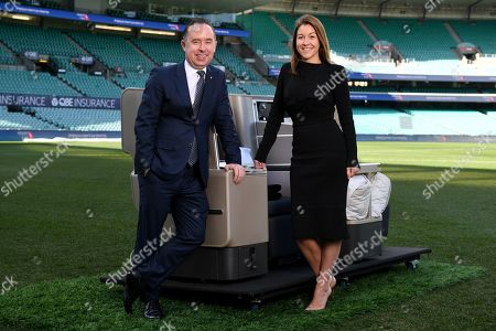 Qantas Group CEO Alan Joyce and Qantas Loyalty CEO Olivia Wirth (R) pose for a photograph at the Sydney Cricket Ground, in Sydney, New South Wales, Australia, 20 June 2019. Qantas has announced a 25 million Australian dollar (17.3 million US dollar) overhaul of its frequent flyer program, cutting fees and making it easier for passengers to cash in their points.
