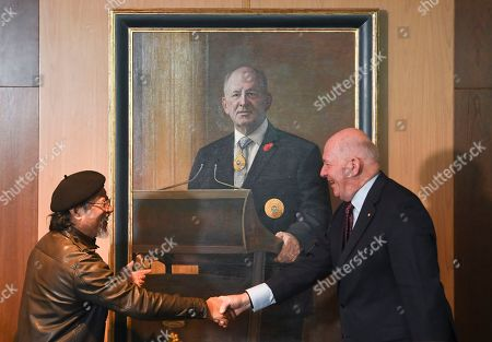 Stock Picture of Outgoing Australian Governor-General Sir Peter Cosgrove and artist Jiawei Shen shake hands during a ceremony to unveil his portrait at Parliament House in Canberra, Australian Capital Territory, Australia, 20 June 2019. The governor-general, who is stepping down from the post on 01 July at the end of his five-year commission, will be replaced by former New South Wales governor David Hurley.