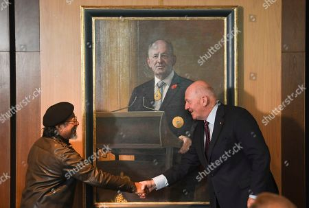 Outgoing Australian Governor-General Sir Peter Cosgrove and artist Jiawei Shen shake hands during a ceremony to unveil his portrait at Parliament House in Canberra, Australian Capital Territory, Australia, 20 June 2019. The governor-general, who is stepping down from the post on 01 July at the end of his five-year commission, will be replaced by former New South Wales governor David Hurley.