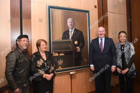 Stock Image of (L-R) Artist Jiawei Shen, Lady Lynne Cosgrove, Outgoing Australian Governor-General Sir Peter Cosgrove and artist Lan Wang pose for photographs during a ceremony to unveil his portrait at Parliament House in Canberra, Australian Capital Territory, Australia, 20 June 2019. The governor-general, who is stepping down from the post on 01 July at the end of his five-year commission, will be replaced by former New South Wales governor David Hurley.