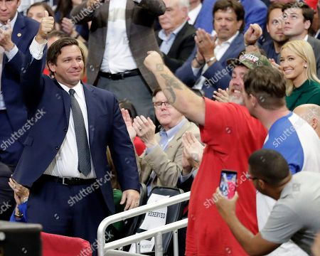Florida Gov. Ron DeSantis, left, waves to supporters after he was introduced at a rally where President Donald Trump formally announced his 2020 re-election bid, in Orlando, Fla