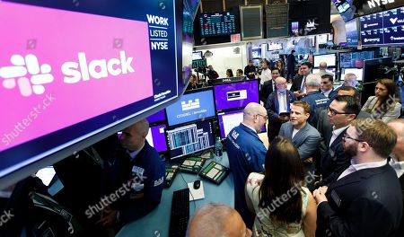 Slack CEO Stewart Butterfield (5-L) talks with traders during the initial public offering for the business team communication company Slack at the New York Stock Exchange in New York, New York, USA, 20 June 2019.