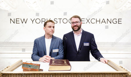 Slack CEO Stewart Butterfield (L) and Chief Technology Officer Cal Henderson (R) stand together during the initial public offering for the business team communication company Slack at the New York Stock Exchange in New York, New York, USA, 20 June 2019.