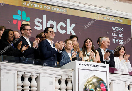 Slack CEO Stewart Butterfield (5-L) and other company representatives ring the opening bell during the initial public offering for the business team communication company Slack at the New York Stock Exchange in New York, New York, USA, 20 June 2019.