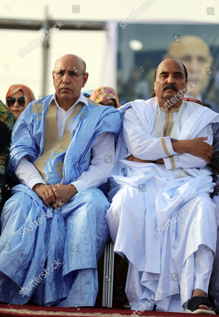 Mohamed Ould Cheikh Mohamed Ahmed Ghazouani, the ruling party's candidate (L)  Mauritania's President Mohamed Ould Abdel Aziz attend a rally in Nouakchott, Mauritania, 20 June 2019. Mauritania will vote on 22 June for the first round of a presidential election for a successor to President Mohamed Ould Abdel Aziz, who is stepping down after his second and final term in office.