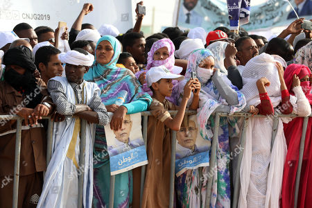 Supporters of Mohamed Ould Cheikh Mohamed Ahmed Ghazouani, the ruling party's candidate, attend a rally in  Nouakchott, Mauritania, 20 June 2019. Mauritania will vote on 22 June for the first round of a presidential election for a successor to President Mohamed Ould Abdel Aziz, who is stepping down after his second and final term in office.