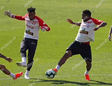 Peru's goalkeeper Pedro Gallese, left, and Jefferson Farfan play with the ball during a training session of the national soccer team in Sao Paulo, Brazil, . Peru will face Brazil on June 22 for a Group A match of the Copa America soccer tournament