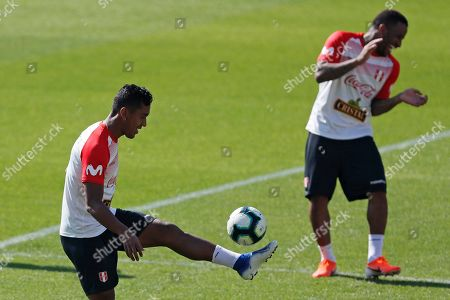 Peru's Renato Tapia, left, and Jefferson Farfan attend a training session of the national soccer team in Sao Paulo, Brazil, . Peru will face Brazil on June 22 for a Group A match of the Copa America soccer tournament