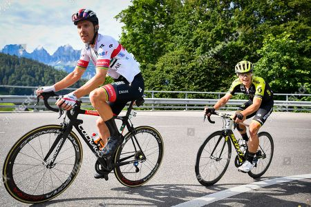 Rui Costa (L) from Portugal of UAE Team Emirates in action during the sixth stage of the 83rd Tour de Suisse UCI ProTour cycling race, over 120.2 km from Einsiedeln to Flumserberg, Switzerland, 20 June 2019.