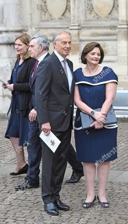Former British prime minister Tony Blair (L) and his wife Cherie (R) and in background Former British prime minister Gordon Brown (R) and his wife Sarah Jane Brown (L)