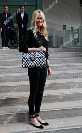 """Former model Claudia Schiffer arrives at the event named """"Karl for Ever"""" at the Grand Palais in Paris, France, . The event pays tribute to late German fashion designer Karl Lagerfeld who died Feb. 19, 2019"""