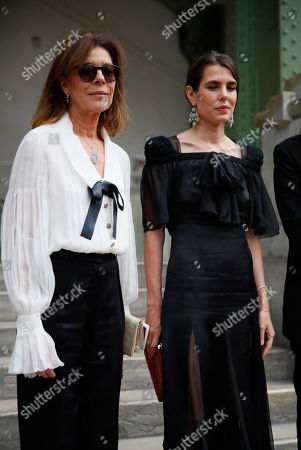 "Princess Caroline of Hanover, left, and Princess Stephanie of Monaco arrive at the event named ""Karl for Ever"" at the Grand Palais in Paris, France, . The event pays tribute to late German fashion designer Karl Lagerfeld who died Feb. 19, 2019"