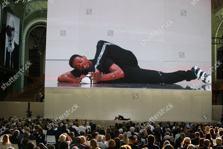 """Lil Buck is seen on a giant screen as he performs on stage during the event named """"Karl for Ever"""" at the Grand Palais in Paris, France, . The event pays tribute to late German fashion designer Karl Lagerfeld who died Feb. 19, 2019"""