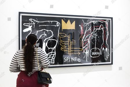A woman observes 'Back of the Neck' artpiece by American artist Jean-Michel Basquiat on display at the 'Basquiat's Defacement' Exhibition in the Solomon R. Guggenheim Museum in New York, New York, USA, 20 June 2019. The exhibition runs from 21 June to 06 November 2019.