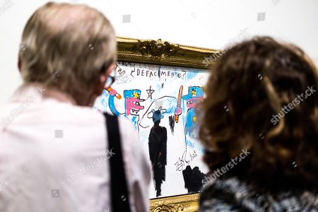 Visitors look on artwork 'The Death of Michael Stewart' by American artist Jean-Michel Basquiat on display at the 'Basquiat's Defacement' Exhibition in the Solomon R. Guggenheim Museum in New York, New York, USA, 20 June 2019. The exhibition runs from 21 June to 06 November 2019.