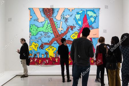 Visitors look on artwork 'Michael Stewart' by American artist Jean-Michel Basquiat on display at the 'Basquiat's Defacement' Exhibition in the Solomon R. Guggenheim Museum in New York, New York, USA, 20 June 2019. The exhibition runs from 21 June to 06 November 2019.