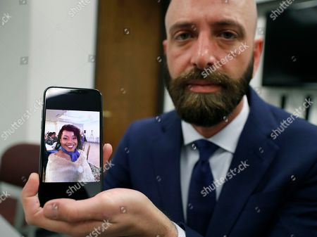 Stock Photo of Eric Ridenhour poses with a photo he took of his fiance Kiersten Smith after giving an interview in Dallas. Smith was killed in the June 9 crane collapse in downtown Dallas