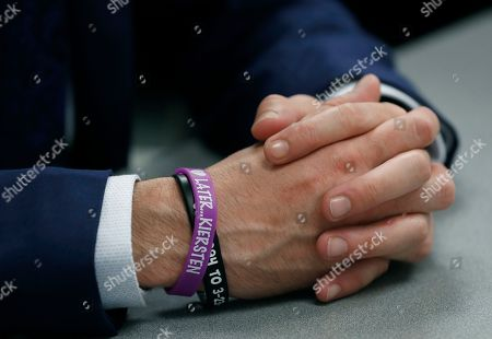 "Eric Ridenhour gives an interview as he clasp his hands revealing a bracelet that reads, ""Later Kiersten,"" referring to his fiance Kiersten Smith, in Dallas. Smith was killed in the June 9 crane collapse in downtown Dallas. Ridenhour said, Smith didn't like saying goodbye, she always said, later"