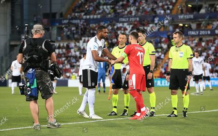 Stock Picture of Jonathan Tah of Germany shakes hands with Andrija Zivkovic of Serbia