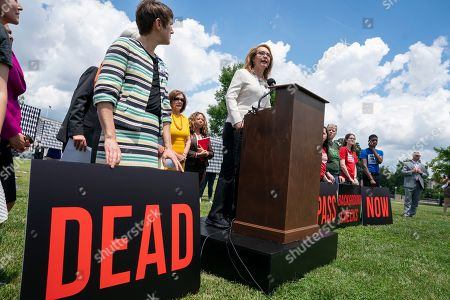 Nancy Pelosi, Gabby Giffords. Former Rep. Gabby Giffords of Arizona, who survived an assassination attempt in 2011, joined at rear by Speaker of the House Nancy Pelosi, D-Calif., speaks at an event event with gun violence prevention advocates, at the Capitol in Washington