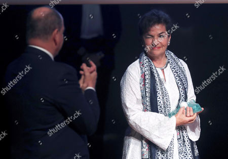 Christiana Figueres, the former Secretary General of the United Nations Framework Convention on Climate Change (UNFCCC) (R), receives the 'Special award' from Prince Albert II of Monaco (L) during the XII Prince Albert II of Monaco Foundation Awards handover ceremony at the Reina Sofia National Art Museum in Madrid, Spain, 20 June 2019.
