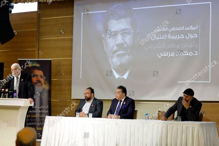 """Arm Adel, Ayman Nour, Mahmoud Hussien, Tarek Zomor. Egyptian politicians, from left, Mahmoud Hussien, speaking, Arm Adel, Ayman Nour, and Tarek Zomor attend a press conference organised by Muslim Brotherhood for former Egyptian president Mohammed Morsi, in Istanbul, . Turkey's President Recep Tayyip Erdogan says his country is determined to ensure that the """"drama"""" surrounding Morsi's death is not forgotten. Erdogan made the comments during a meeting with a group of foreign journalists on Thursday, a day after he claimed that Morsi didn't die of natural causes but was killed"""