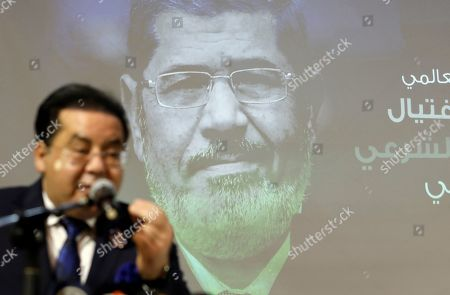"""Stock Picture of Egyptian politician Ayman Nour speaks during a press conference organised by Muslim Brotherhood for former Egyptian president Mohammed Morsi, in Istanbul, . Turkey's President Recep Tayyip Erdogan says his country is determined to ensure that the """"drama"""" surrounding Morsi's death is not forgotten. Erdogan made the comments during a meeting with a group of foreign journalists on Thursday, a day after he claimed that Morsi didn't die of natural causes"""