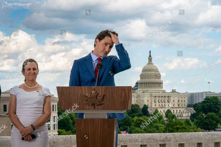 Justin Trudeau, Chrystia Freeland. Canadian Prime Minister Justin Trudeau, with Foreign Affairs Minister Chrystia Freeland, left, speaks to reporters from the roof of the Canadian Embassy in Washington after a day of meetings with President Donald Trump and leaders in Congress focusing on a replacement for the North American Free Trade Agreement