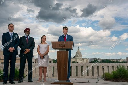 Justin Trudeau, Chrystia Freeland, Harjit Sajjan, Bill Morneau. Canadian Prime Minister Justin Trudeau speaks to reporters from the roof of the Canadian Embassy in Washington after a day of meetings with President Donald Trump and leaders in Congress focusing on a replacement for the North American Free Trade Agreement, . He is joined by, from left, Finance Minister Bill Morneau, Minister of National Defence Harjit Sajjan, and Foreign Affairs Minister Chrystia Freeland