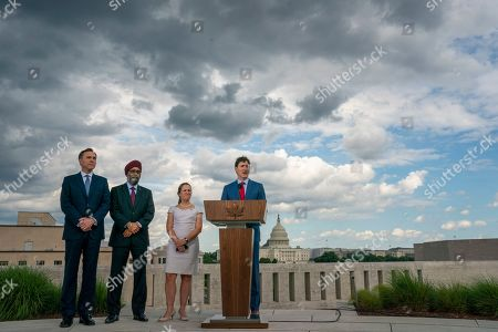 Justin Trudeau, Chrystia Freeland, Harjit Sajjan, Bill Morneau. Canadian Prime Minister Justin Trudeau speaks to reporters from the roof of the Canadian Embassy in Washington after a day of meetings with President Donald Trump and leaders in Congress focusing on a replacement for the North American Free Trade Agreement, . He is joined, from left, by, Finance Minister Bill Morneau, Minister of National Defence Harjit Sajjan, and Foreign Affairs Minister Chrystia Freeland