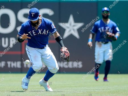 Stock Picture of Rougned Odor, Danny Santana. Texas Rangers second baseman Rougned Odor reaches down to collect a ball he allowed to fall in front of him that was popped up by Cleveland Indians' Jose Ramirez, as right fielder Danny Santana, rear, watches in the fourth inning of a baseball game in Arlington, Texas, . Ramirez was thrown out at first and Carlos Santana was doubled off in a run down on the play