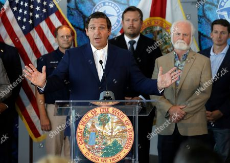 Florida Gov. Ron DeSantis speaks after signing a red tide mitigation and technology development initiative into law during a news conference at Mote Marine Laboratory, in Sarasota, Fla. DeSantis says Florida will commit $3 million for the next five years for the purpose of prioritizing red tide prevention