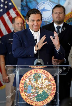 Florida Gov. Ron DeSantis speaks after signing a red tide mitigation and technology development initiative into law during a news conference at Mote Marine Laboratory, in Sarasota, Fla. DeSantis says Florida will commit $3 million a year for the next five years for the purpose of prioritizing red tide prevention