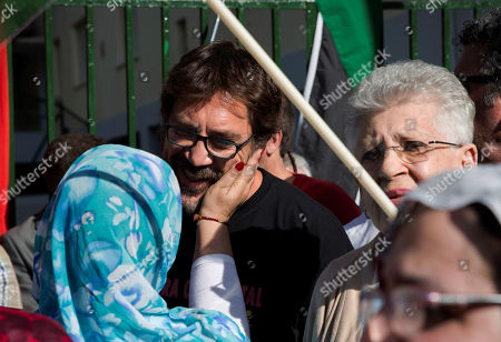 Spanish actor Javier Bardem (C) and his mother Spanish actress Pilar Bardem (R) attend a march against the repression of the people in Western Sahara held next to Moroccan Embassy in Madrid, Spain, 20 June 2019.