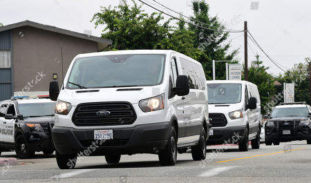 Jury's vans arrive under escort for a visit of an evidence site located at 4626 Arden Way in El Monte during the murder trial of Michael Gargiulo in Los Angeles, California, USA, 20 June 2019. Gargiulo is charged in the stabbing deaths of two women, one of whom was about to go out with actor Ashton Kutcher that night, as well as attempting to kill a woman during a robbery at her Santa Monica home.