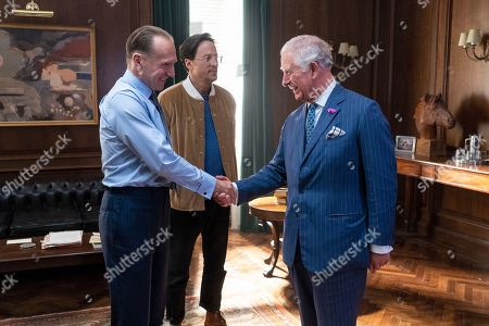 Prince Charles greets actor Ralph Fiennes (L) and director Cary Fukunaga