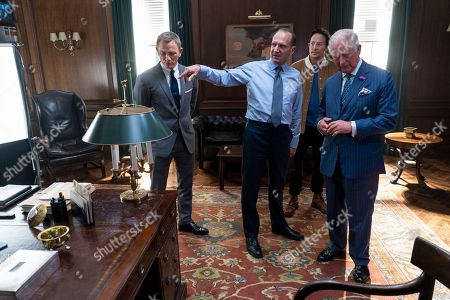 Prince Charles greets actors Daniel Craig and Ralph Fiennes (L), and director Cary Fukunaga