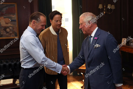 Prince Charles greets actor Ralph Fiennes (L), and director Cary Fukunaga
